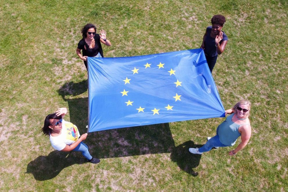 Four women holding an EU flag